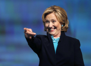 Former Secretary of State Hillary Rodham Clinton reacts as she is introduced to speak at the Massachusetts Conference for Women in Boston, Thursday, Dec. 4, 2014. (AP Photo/Elise Amendola)