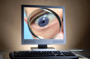 Local Input~ FOR NATIONAL POST USE ONLY - Monitoring from the InterNet. Credit: fotolia. Keywords:  omputer; Monitor; Tastatur; Auge; Lupe; Schreibtisch; Buero; sehen; schauen; Blick; blicken; Einblick; ueberwachen; Ueberwachung; Internet; online; Durchsuchung; spionieren; Spionage; Spion; Detektiv; Ermittler; Ermittlung; Untersuchung; untersuchen; Kriminalitaet; kriminell; Gesetz; gesetzlich; ungesetzlich; strafbar; Strafe; strafen; bestrafen; Spurensuche; Spur; Verdacht; verdaechtigen; Privatsphaere; privat; software; Virus; malware; spyware; Trojaner; trojanisch; keyboard; eye; magnifying glass; desk; office; see; look; to view; view; supervise; to monitoring; look to InterNet; on-line; search; spy; espionage; feeler gauge; detective; Ermittler; determination; investigation; examine; criminality; criminally; law; legally; illegally; punishable; punishment; punish; tracing; trace; suspicion; suspect; privately; times commodity; trojan