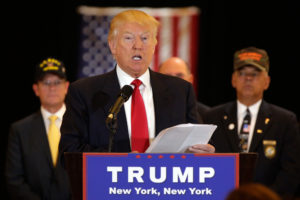 Republican presidential candidate Donald Trump reads from a list of donations to veteran's groups, during a news conference in New York, Tuesday, May 31, 2016. (AP Photo/Richard Drew) ORG XMIT: NYRD102